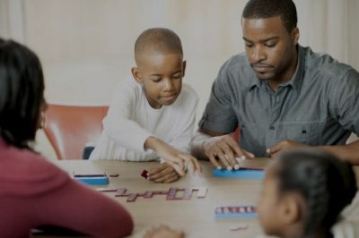 An African-American family having a game night together